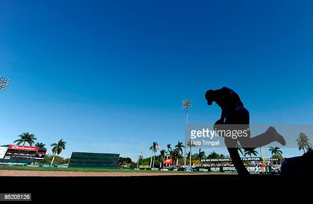 A player with the Cincinnati Reds runs out onto the field during a game against the Boston Red Sox at the City of Palms Park on March 3 2009 in Fort...