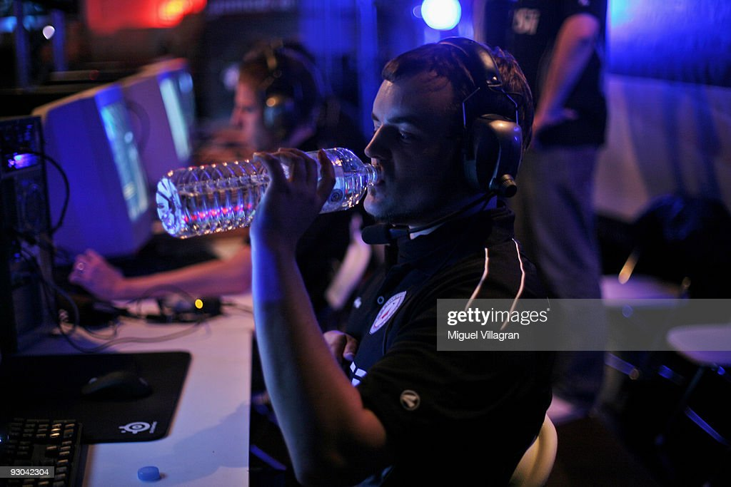 A player with the nickname 'threeman' drinks water as he plays Counter Strike during the 'Intel Friday Night Game' organized by the Electronic Sports League at Tonhalle on November 13, 2009 in Munich, Germany. Germany's best electronic sports teams meet to play against each other.
