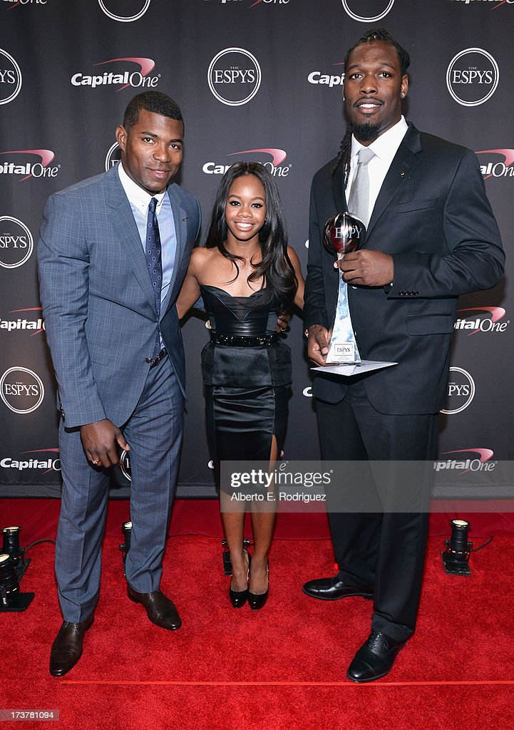 MLB player <a gi-track='captionPersonalityLinkClicked' href=/galleries/search?phrase=Yasiel+Puig&family=editorial&specificpeople=10484087 ng-click='$event.stopPropagation()'>Yasiel Puig</a>, Olympic athlete <a gi-track='captionPersonalityLinkClicked' href=/galleries/search?phrase=Gabby+Douglas&family=editorial&specificpeople=8465211 ng-click='$event.stopPropagation()'>Gabby Douglas</a>, and Best Play award winner <a gi-track='captionPersonalityLinkClicked' href=/galleries/search?phrase=Jadeveon+Clowney&family=editorial&specificpeople=7471550 ng-click='$event.stopPropagation()'>Jadeveon Clowney</a> pose backstage at The 2013 ESPY Awards at Nokia Theatre L.A. Live on July 17, 2013 in Los Angeles, California.