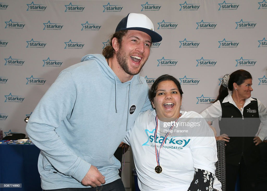 NFL player <a gi-track='captionPersonalityLinkClicked' href=/galleries/search?phrase=Zach+Sudfeld&family=editorial&specificpeople=9688780 ng-click='$event.stopPropagation()'>Zach Sudfeld</a> and patient Doaa attend the Starkey Hearing Foundation hearing mission during Super Bowl weekend 2016 at San Francisco State University on February 6, 2016 in San Francisco, California.