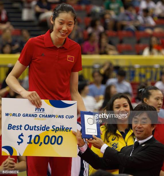 Player Zhu Ting of the Chinese national women's volleyball team poses with her trophy of the Best Outside Spiker during the award ceremony of the...