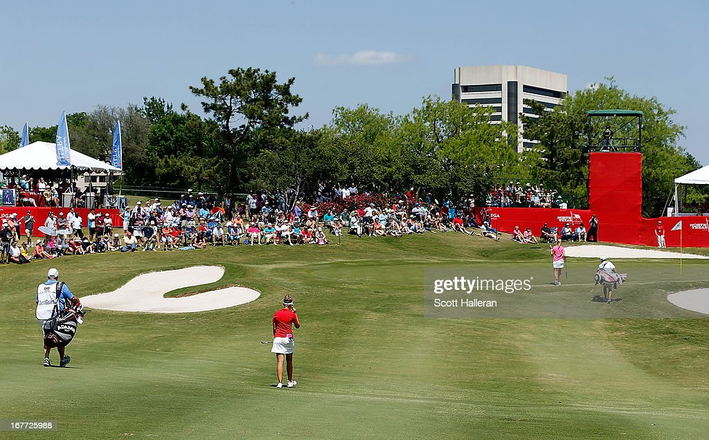Players and caddies approach the 18th green during the final round of the 2013 North Texas LPGA Shootout at the Las Colinas Counrty Club on April 28, 2013 in Irving, Texas.