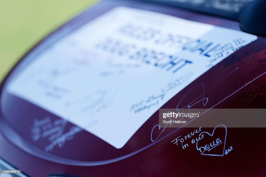 LPGA players and caddies signed a golf cart on the 17th hole in memory of longtime rules official Doug Brecht who died after a three-month battle with the West Nile virus, during the third round of the CME Group Titleholders at the TwinEagles Club on November 17, 2012 in Naples, Florida.