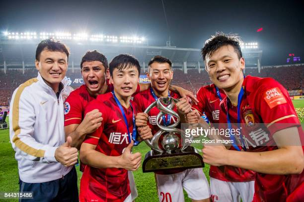 Players and coach of Guangzhou Evergrande hold the AFC Champions League Final Trophy for photo after winning the 2015 AFC Champions League Final...