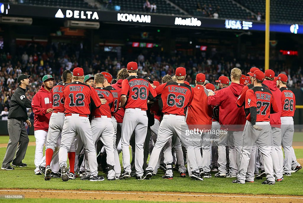 Players and coaches from Mexico and Canada come together in an on field altercation during the World Baseball Classic First Round Group D game at Chase Field on March 9, 2013 in Phoenix, Arizona.