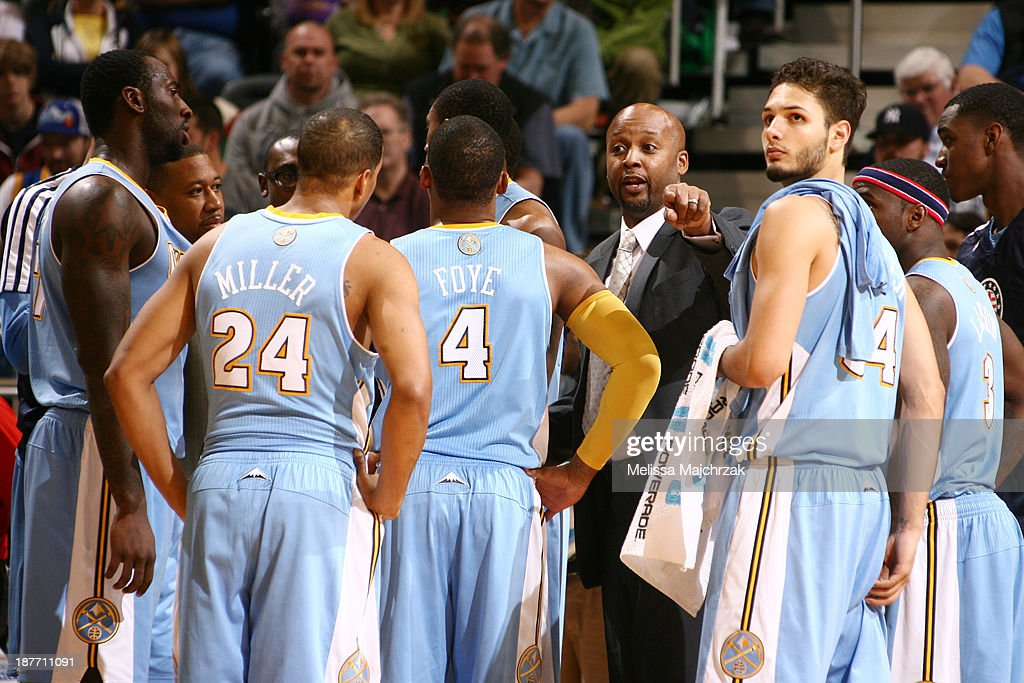 Players and Coaches of the Denver Nuggets meet during a timeout against the Utah Jazz at EnergySolutions Arena on November 11, 2013 in Salt Lake City, Utah.