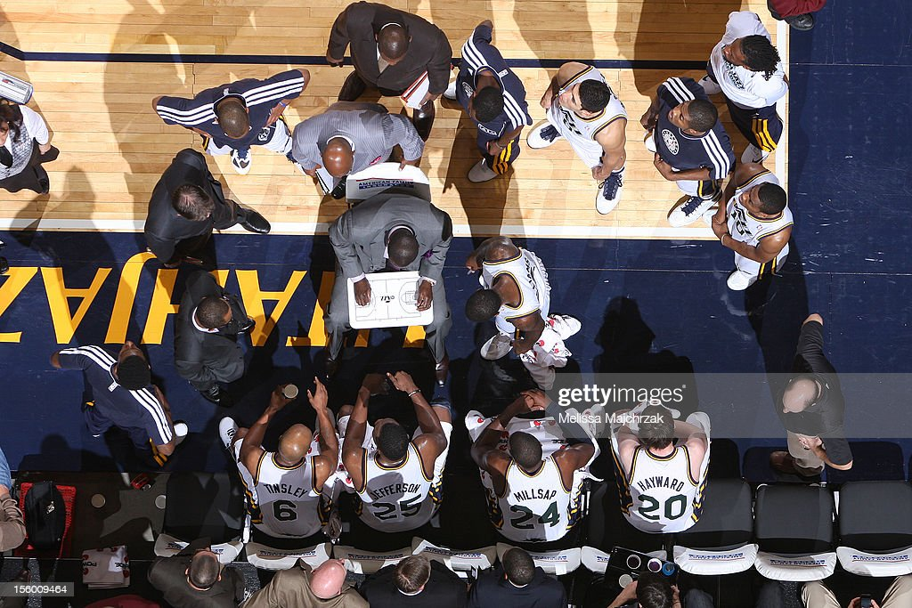 Players and coaches of the Utah Jazz meet during a timeout while playing the Phoenix Suns at Energy Solutions Arena on November 10, 2012 in Salt Lake City, Utah.