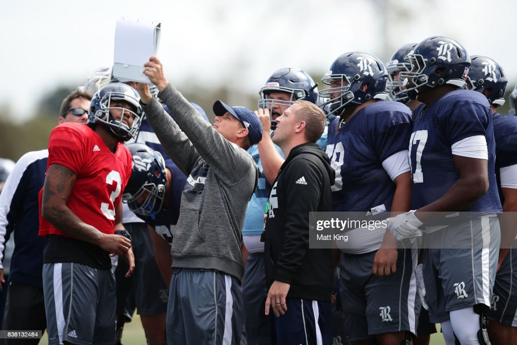 Players and coaches set a play during a Rice University College Football training session at David Phillips Sports Complex on August 24, 2017 in Sydney, Australia.