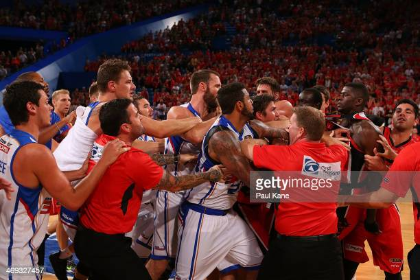 Players and coaching staff from both sides remonstrate in a post game melee during the round 18 NBL match between the Perth Wildcats and the Adelaide...