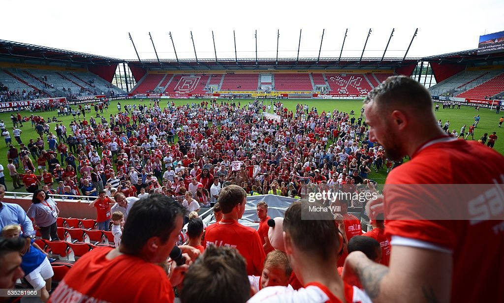 Players and fans celebrate Regensburgs celebrate their teams victory in the Third League play off second leg match between Jahn Regensburg and VfL Wolfsburg II at Continental Arena on May 29, 2016 in Regensburg, Germany.