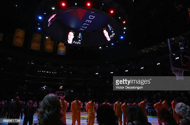 Players and fans observe a moment of silence for former NBA and exLakers player Jack Haley prior to the NBA game between the Utah Jazz and the Los...