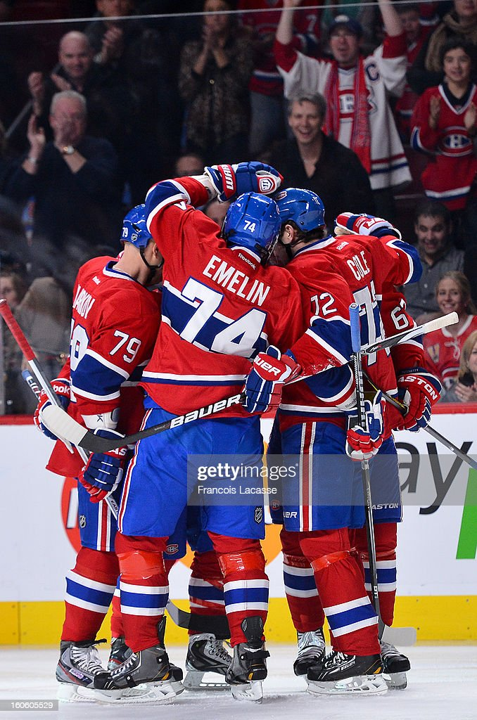 Players and fans of the Montreal Canadiens celebrate a goal during the NHL game against the Ottawa Senators on February 3, 2013 at the Bell Centre in Montreal, Quebec, Canada.