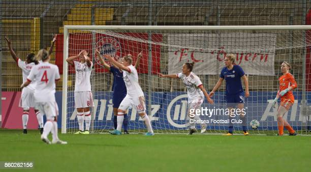 Players and goalkeeper Hedvig Lindahl of Chelsea FC and players of FC Bayern Muenchen react after a goal not given during the Champions League round...
