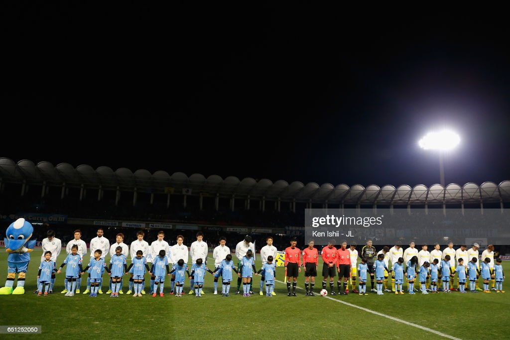 Players and match officials observe a minute of silence to commemorate the victims of the Great East Japan Earthquake and following tsunami 6 years ago prior to the J.League J1 match between Kawasaki Frontale and Kashiwa Reysol at Todoroki Stadium on March 10, 2017 in Kawasaki, Kanagawa, Japan.