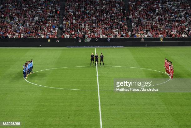 Players and match officials observe a minute's silence in memory of the victims of Thursday's terrorist attacks in Spain prior to the Bundesliga...