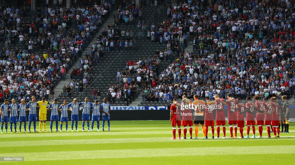 Players and match officials observe a minute's silence in memory of the victims of Thursday's terrorist attacks in Spain during the Bundesliga match between Hertha BSC and VfB Stuttgart at Olympiastadion on August 19, 2017 in Berlin, Germany.