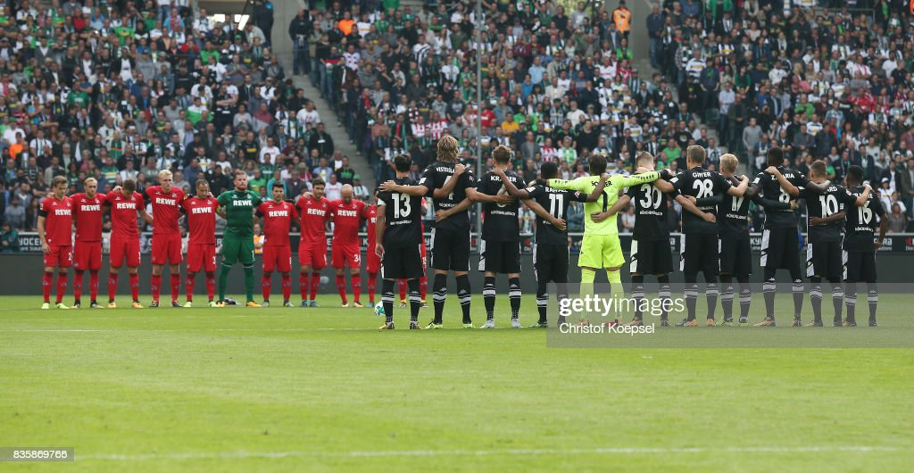 Players and match officials observe a minute's silence in memory of the victims of Thursday's terrorist attacks in Spain during the Bundesliga match between Borussia Moenchengladbach and 1. FC Koeln at Borussia-Park on August 20, 2017 in Moenchengladbach, Germany.