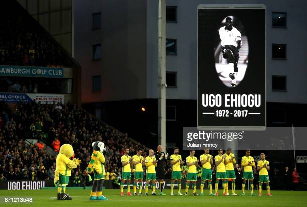 Players and match officials observe a silence in remembrance of Ugo Ehiogu during the Sky Bet Championship match between Norwich City and Brighton...