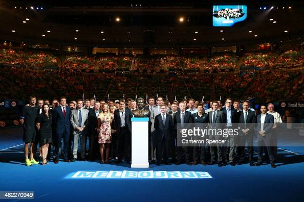 Players and officials gather on Rod Laver Arena during the unveiling of a bronze bust of Brad Drewett during day one of the 2014 Australian Open at...