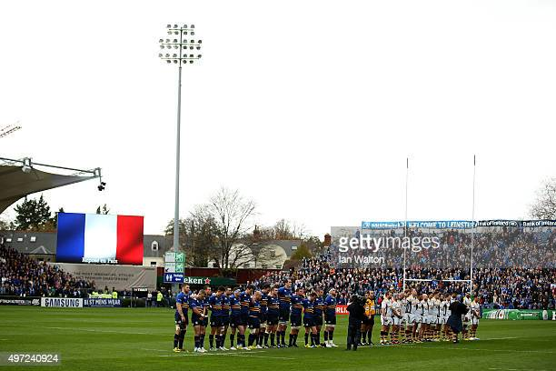 Players and Officials line up for a one minute silence over the terrorist attacks in Paris during the European Rugby Champions Cup match between...