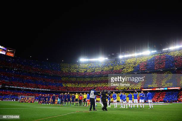 Players and officials line up on the pitch prior to the La Liga match between FC Barcelona and Real Madrid CF at Camp Nou on March 22 2015 in...
