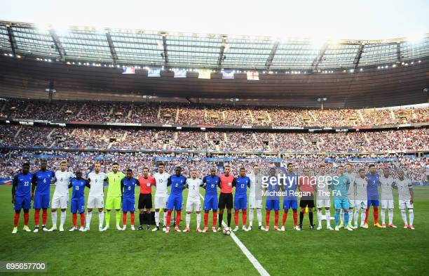 Players and officials line up prior to the International Friendly match between France and England at Stade de France on June 13 2017 in Paris France