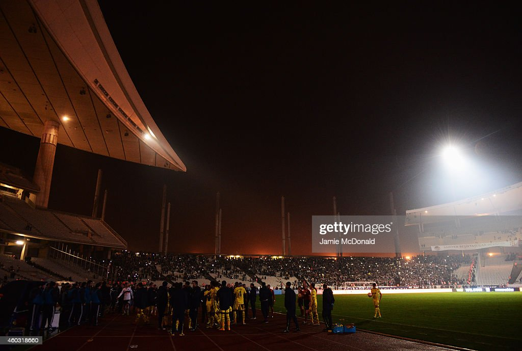 Players and officials look on as play is suspended following a floodlight failure for a second time during the UEFA Europa League Group C match between Besiktas JK and Tottenham Hotspur FC at Ataturk Olympic Stadium on December 11, 2014 in Istanbul, Turkey.