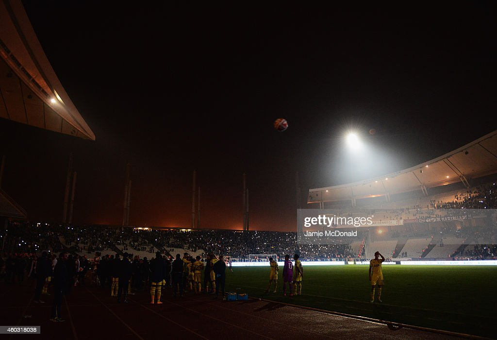 Players and officials looks on as play is suspended following a floodlight failure for a second time during the UEFA Europa League Group C match between Besiktas JK and Tottenham Hotspur FC at Ataturk Olympic Stadium on December 11, 2014 in Istanbul, Turkey.