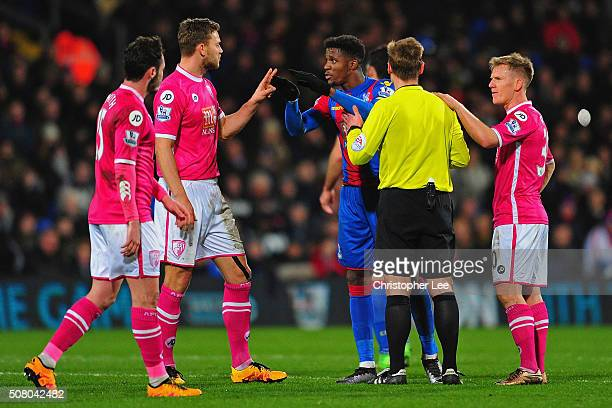 Players and referee Mike Jones separate Wilfried Zaha of Crystal Palace and Adam Smith of Bournemouth during the Barclays Premier League match...