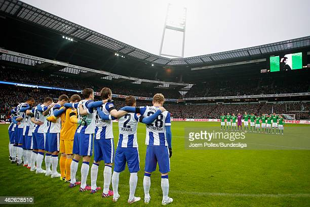 Players and referees obtain a minute of silence to commemorate VfL Wolfsburg player Junior Malanda prior to the Bundesliga match between Werder...