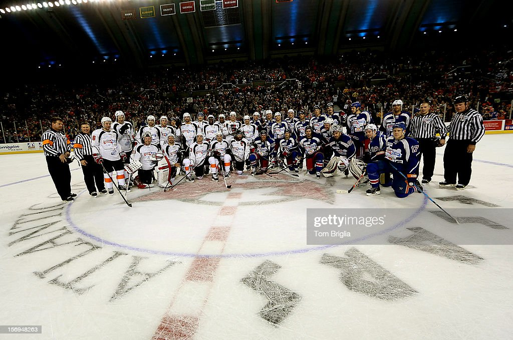 Players and referees pose for a group shoot after Operation Hat Trick Benefit Exhibition Hockey Game at Boardwalk Hall Arena on November 24, 2012 in Atlantic City, New Jersey.