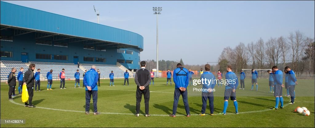 Players and staff from Genk football team hold a minutes silence on the day of national mourning on March 16,2012 in Genk,Belgium. Belgium held a national day of mourning to remember all the who died in a coach crash earlier this week. The accident occurred when a school bus carrying 11 -12 year olds, returning from a skiing holiday, crashed into a tunnel wall, killing 28 of the 52 passengers.