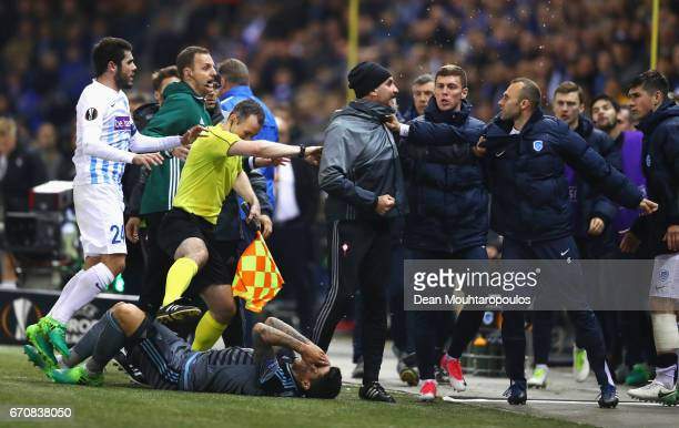 Players and staff of Celta Vigo and Genk clash during the UEFA Europa League quarter final second leg between KRC Genk and Celta Vigo at Luminus...