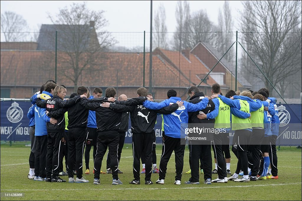 Players and staff of footballl team Club Brugge KV hold a minutes silence on the day of national mourning on March 16,2012 in Brugge,Belgium. Belgium held a national day of mourning to remember all the who died in a coach crash earlier this week. The accident occurred when a school bus carrying 11 -12 year olds, returning from a skiing holiday, crashed into a tunnel wall, killing 28 of the 52 passengers.