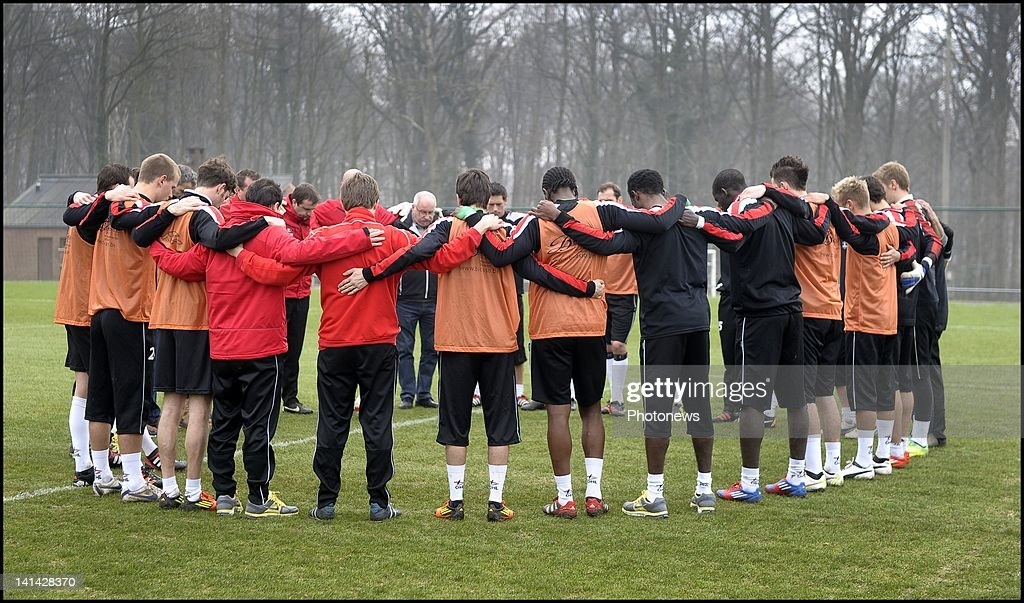 Players and staff of footballl team OH Leuven hold a minutes silence on the day of national mourning on March 16,2012 in Leuven,Belgium. Belgium held a national day of mourning to remember all the who died in a coach crash earlier this week. The accident occurred when a school bus carrying 11 -12 year olds, returning from a skiing holiday, crashed into a tunnel wall, killing 28 of the 52 passengers.