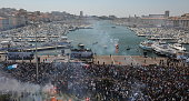 Players and staff of Marseille celebate the Ligue 1 Championship with their fans in Marseille France