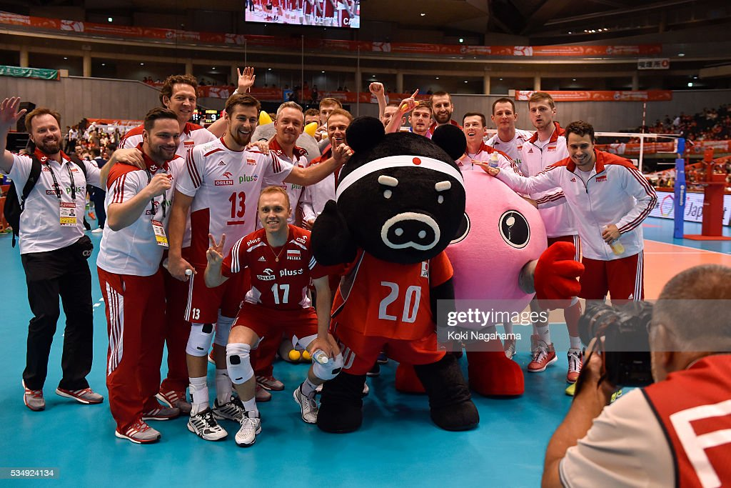 Players and staff of Poland pose for photographs after winning the Men's World Olympic Qualification game between Poland and Canada at Tokyo Metropolitan Gymnasium on May 28, 2016 in Tokyo, Japan.