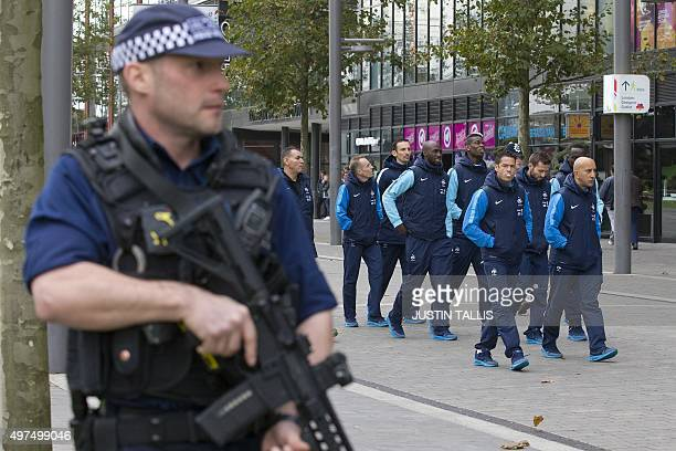 Players and staff of the France football team go for a morning walkabout escorted by British armed police around Wembley Stadium in west London on...
