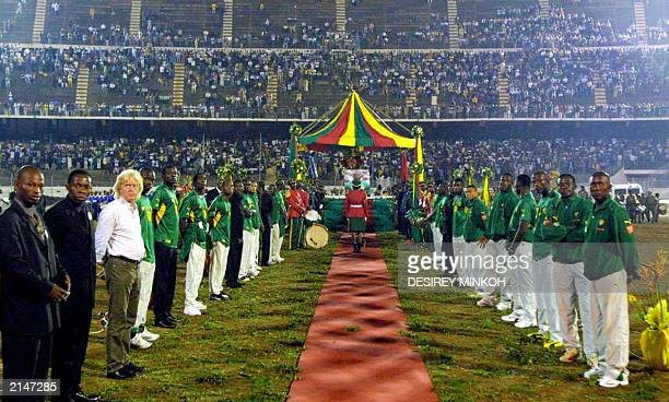 Players and staff of the Lions Indomptables of Cameroon form a cortege at the bier of Cameroon soccer player MarcVivien Foe in Amadou Ahidjo stadium...