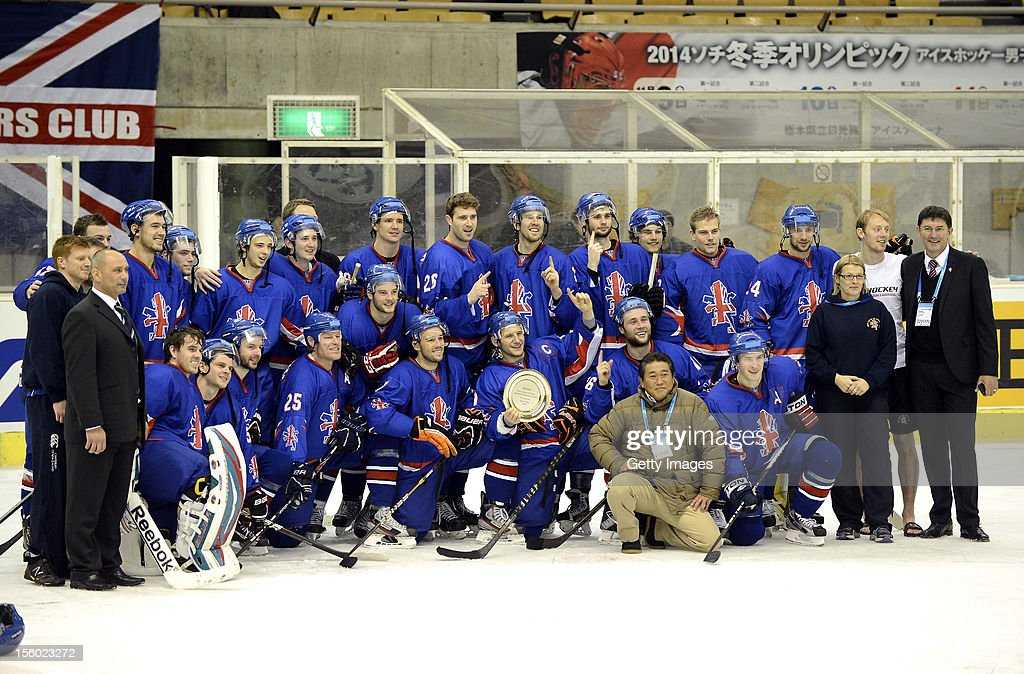 Players and staffs of Great Britain pose for photographs after the Ice Hockey Sochi Olympic Pre-Qualification Group J match between Japan and Great Britain at Nikko Kirifuri Ice Arena on November 11, 2012 in Nikko, Japan. Great Britain won 2-1 and went through to the final qualification.