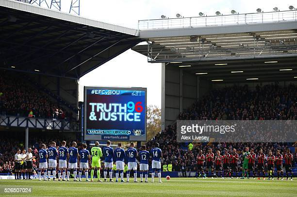 Players and supporters observe a minute of silence for the victims of the Hillsborough disaster prior to the Barclays Premier League match between...