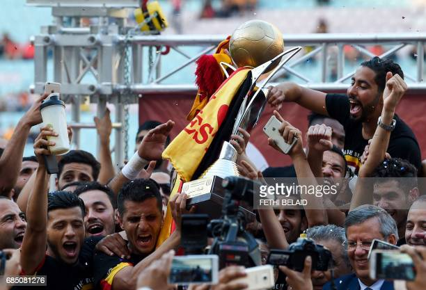 Players and supporters of Esperance de Tunis celebrate with the trophy after winning the Tunisian Championship match against Etoile du Sahel at the...