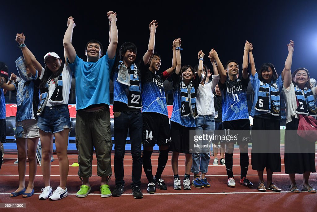 Players and supporters of Kawasaki Frontale celebrate the win after the JLeague match between Kawasaki Frontale and Ventforet Kofu at the Todoroki...