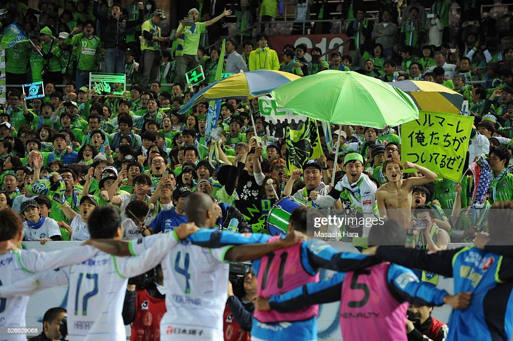 Players and supporters of Shonan Bellmare celebrates the win after the J.League match between Yokohama F.Marinos and Shonan Bellmare at the Nissan stadium on April 30, 2016 in Yokohama, Kanagawa, Japan.