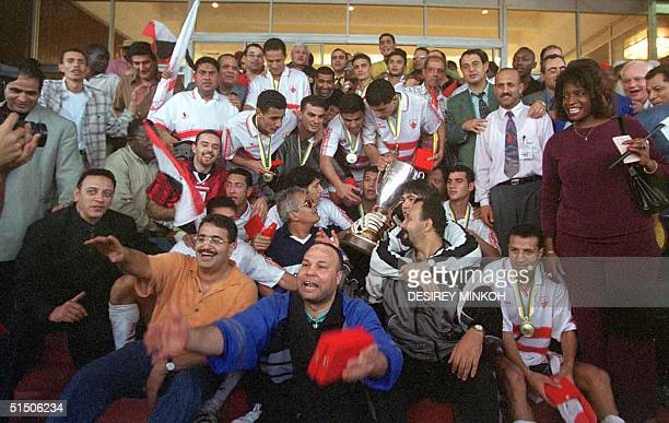 Players and supporters of the Egypt's Zamalek pose after they won the 26th African cup Winners cup at the Ahmadou Ahijdo Stadium 10 December 2000 in...