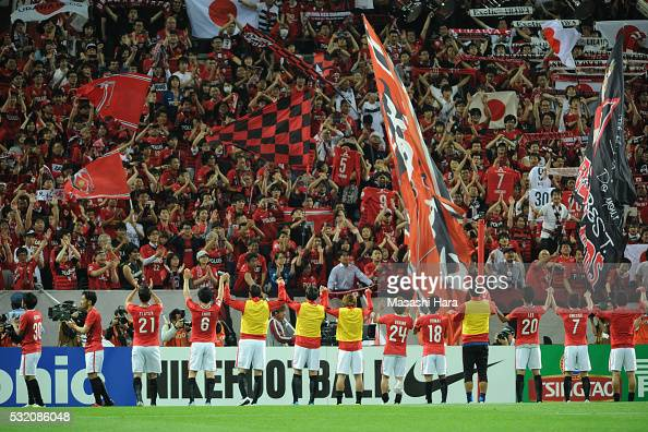 Players and supporters of Urrawa Red Diamonds celebrate the win after the AFC Champions League Round of 16 First Leg match between Urawa Red Diamonds...