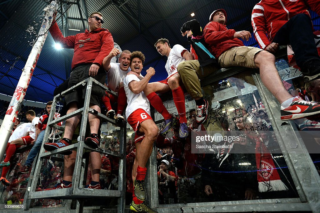 Players and supporters of Wuerzburg celebrate after winning the 2. Bundesliga playoff leg 2 match against MSV Duisburg at Schauinsland-Reisen-Arena on May 24, 2016 in Duisburg, Germany.