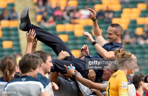 Players and team members of England throw Head coach Mark Sampson of England in the air after winning the FIFA Women's World Cup 2015 Third Place...