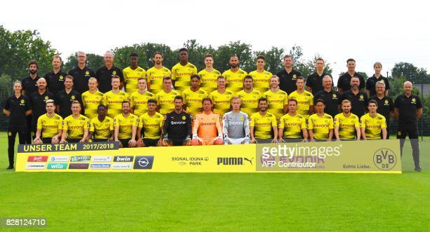 Players and team members of German first division Bundesliga football club Borussia Dortmund pose for a team photo on August 9 2017 in Dortmund...