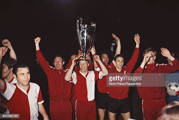 Players and team members of the Dutch football club Feyenoord celebrate with the trophy after beating Celtic 21 after extra time in the final of the...